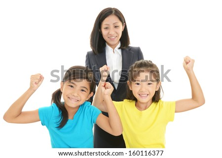 Smiling girls with teacher - stock photo