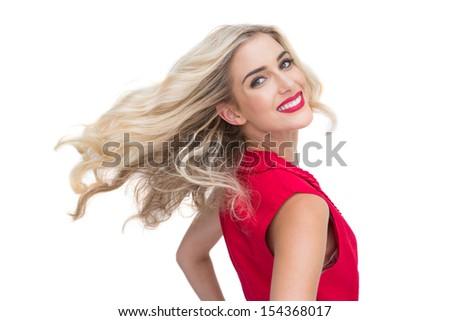 Smiling glamorous blonde posing on white background - stock photo