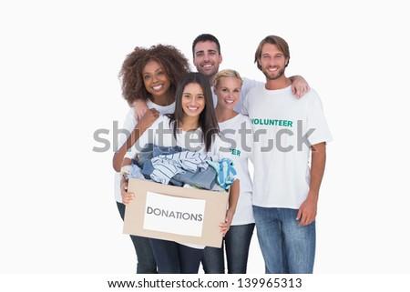 Smiling group of volunteers holding donation boxvolunteers  on white background - stock photo