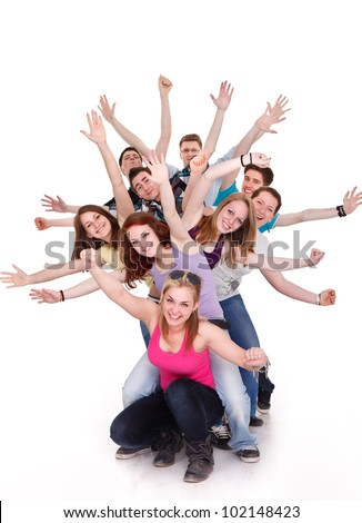 Smiling group of young friends having fun with outstretched arms - stock photo