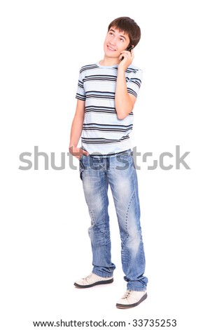 Smiling guy with a mobile phone over white background - stock photo
