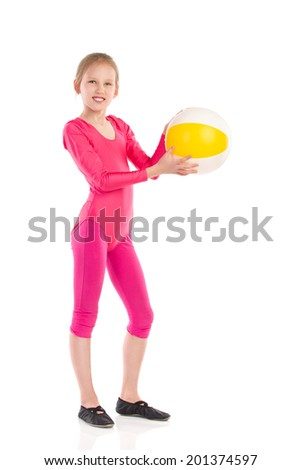 Smiling gymnastics girl standing and holding a ball. Full length studio shot isolated on white. - stock photo