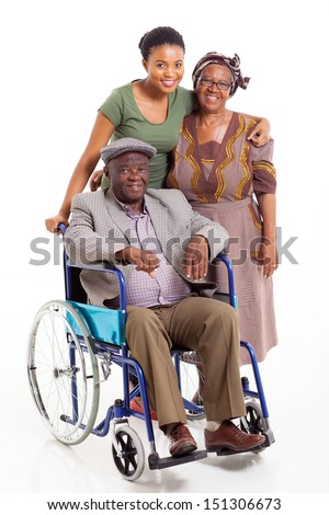 smiling handicapped african man with wife and daughter isolated on white - stock photo