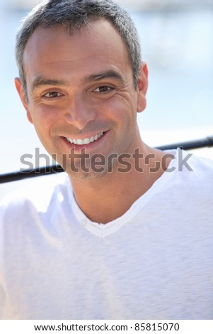 Smiling handsome man - stock photo