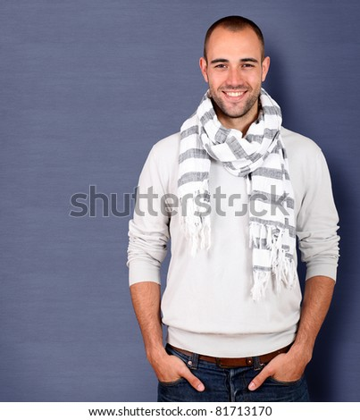 Smiling handsome man wearing scarf - stock photo