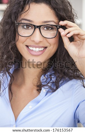 Smiling happy beautiful young woman or girl wearing geek glasses  - stock photo