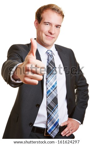Smiling happy business man holding his thumbs up - stock photo