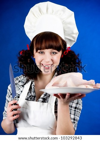 Smiling happy cook woman holds a Crude hen - stock photo