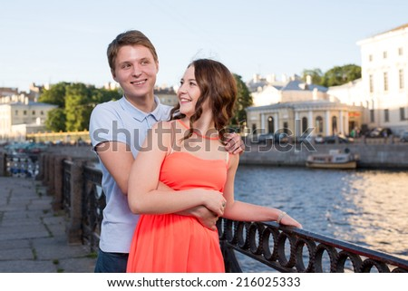 Smiling happy couple outdoor at the city - stock photo