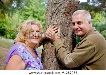 Smiling happy elderly couple in love outdoor - stock photo