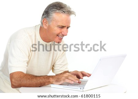 Smiling happy elderly man with laptop.  Isolated over white background - stock photo