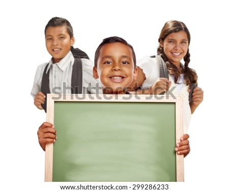 Smiling Happy Hispanic Boys and Girl Holding Blank Chalk Board Isolated on White. - stock photo