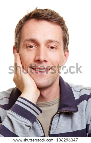 Smiling happy relaxed man with hand on chin - stock photo