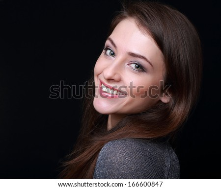 Smiling happy woman looking on black background - stock photo