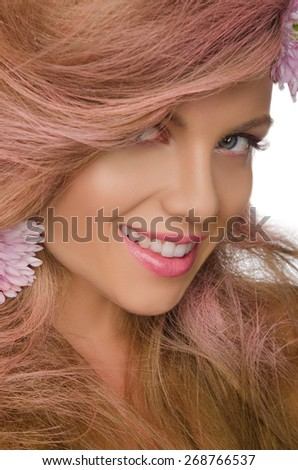 Smiling happy woman with pink hair and flowers - stock photo
