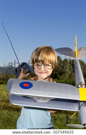 Smiling happy young boy and his RC plane - stock photo