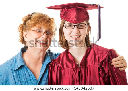 Smiling high school graduate and her proud mother.  White background. - stock photo