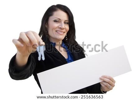 Smiling Hispanic Woman Holding Blank Sign and Keys Isolated On White. - stock photo