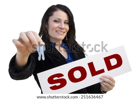 Smiling Hispanic Woman Holding Sold Real Estate Sign and Keys Isolated On White. - stock photo