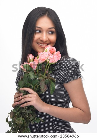 Smiling indian girl with pink roses - stock photo