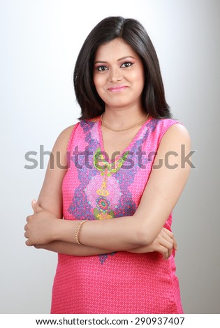 Smiling Indian woman arms crossed  - stock photo