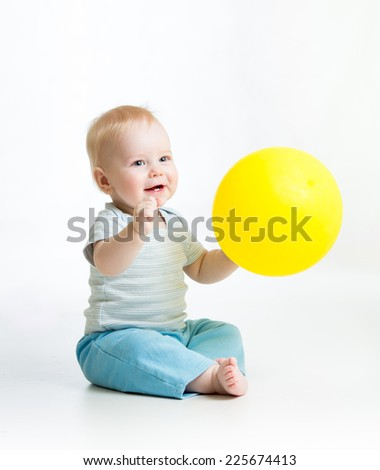 Smiling kid boy with yellow ballon in his hand - stock photo