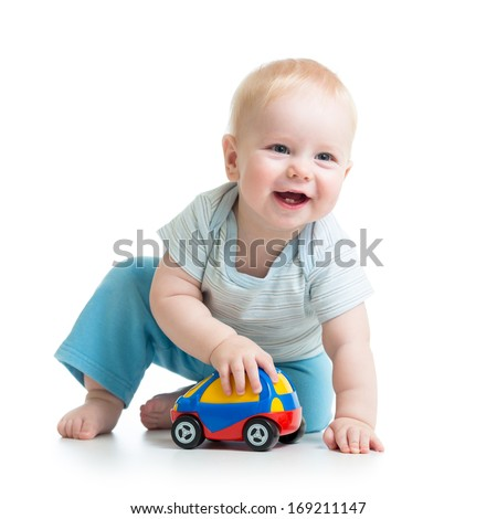 smiling kid playing with toy - stock photo