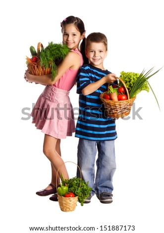 Smiling kids standing with fresh vegetables in baskets, isolated on white - stock photo