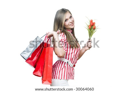 Smiling lady after shopping with tulips, isolated on white - stock photo