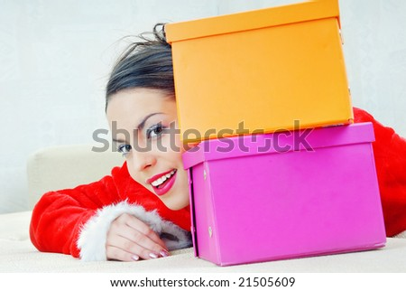 Smiling lady behind the boxes with bought gifts - stock photo