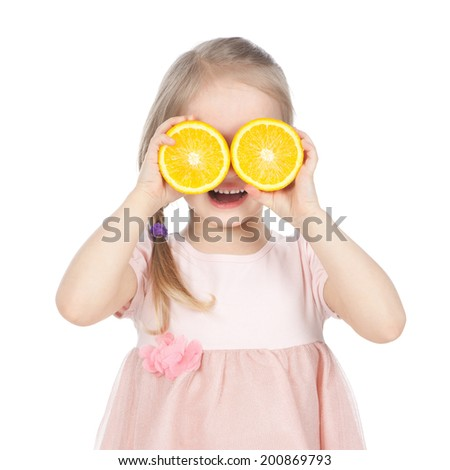 Smiling little blonde girl holding fresh oranges on white background - stock photo