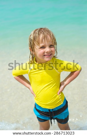 Smiling  little boy on the beach - stock photo