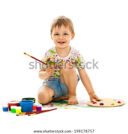 Smiling little boy painting, isolated on white background - stock photo