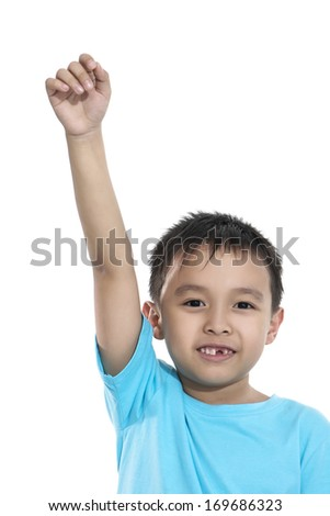 smiling little boy raised his hands up - stock photo