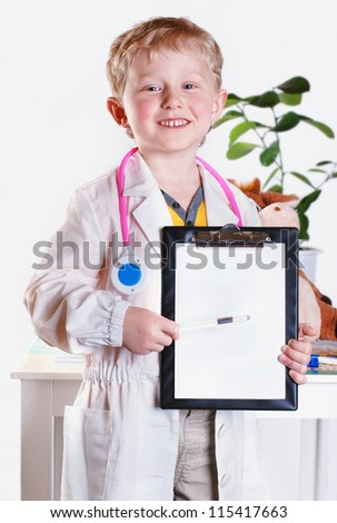 Smiling little doctor with clip board in hands - stock photo