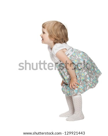 Smiling little girl bending and waiting something; isolated on white - stock photo