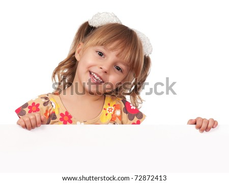 Smiling little girl holding empty white board - stock photo