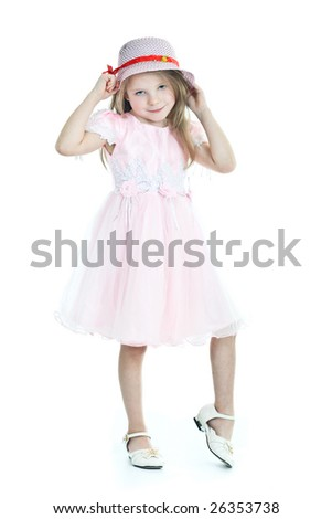 Smiling  little girl in pink dress and hat - stock photo
