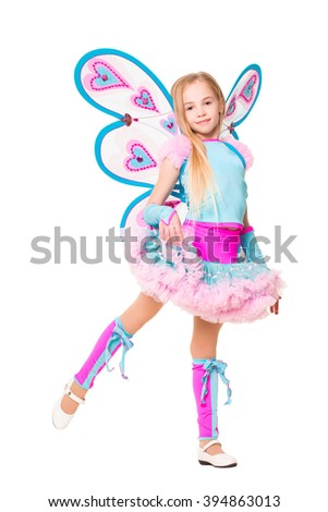 Smiling little girl showing her blue carnival costume. Isolated on white - stock photo