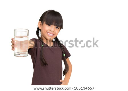 Smiling little girl with a water glass on white background - stock photo