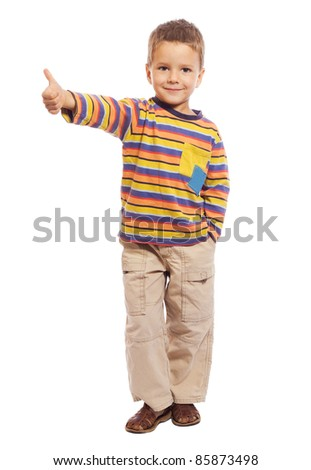 Smiling little kid with thumbs up sign, isolated on white - stock photo