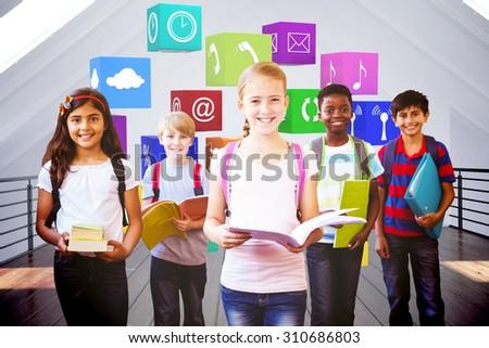 Smiling little school kids in school corridor against white room - stock photo