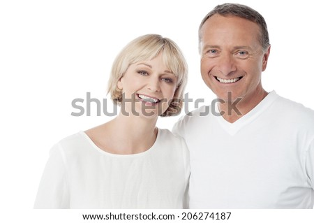 Smiling loving couple standing on white background - stock photo