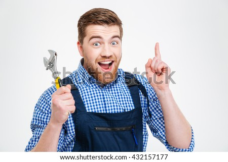 Smiling male builder showing finger up isolated on a white background. I having idea - stock photo