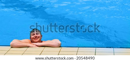 Smiling man at the pool - stock photo