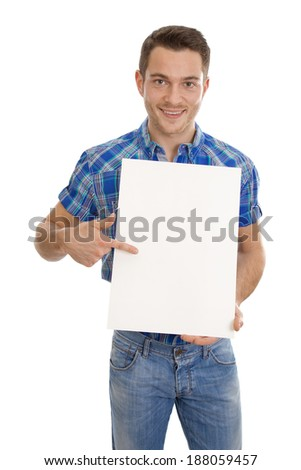 Smiling man holding a white sign in his hands. - stock photo