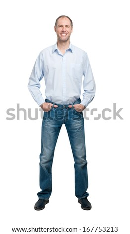 Smiling man in blue shirt and jeanse isolated on white background - stock photo