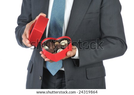 Smiling Man in Suit holding Red Heart Candy Box isolated over white, torso only - stock photo