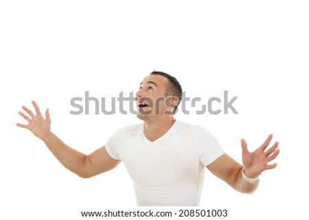 smiling man looking up with a slightly raised his hands as if collecting or catches money - stock photo
