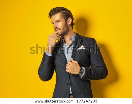 Smiling man on yellow background - stock photo